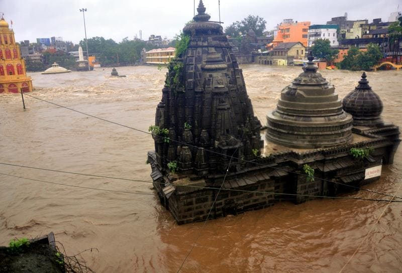 Godavari river overflowing at Ramkund area. After the heavy rain, two major rivers Godavari and Kadwa has touched danger line in Nashik, India, on Tuesday.