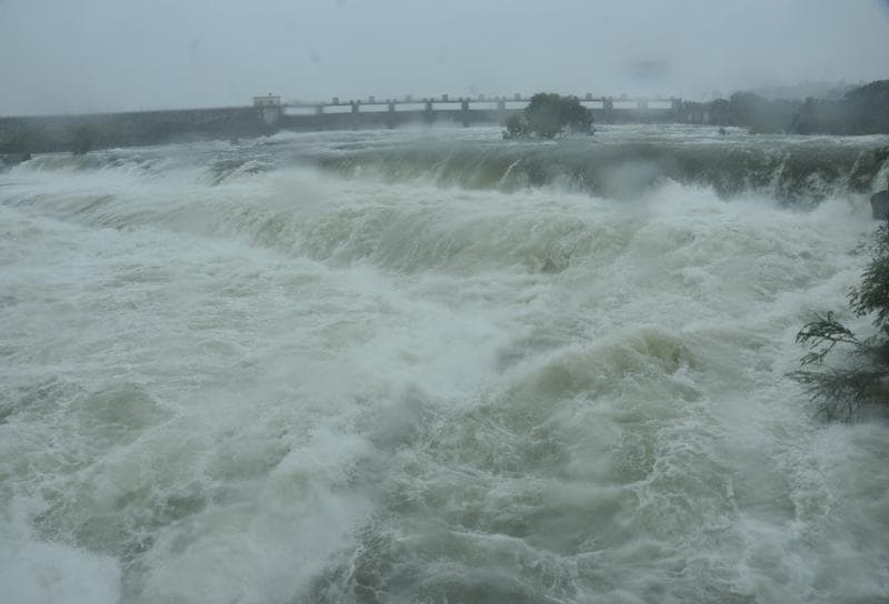 Water level rises in Kadakwasla dam, after heavy spell of rain in Pune, India, on Wednesday.
