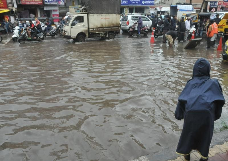 Flooded street at Manikbag, Sinhgad road after heavy rain in Pune, India, on Wednesday.