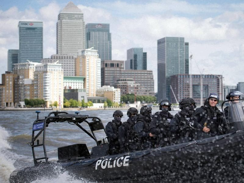 "Armed Metropolitan Police counter terrorism officers take part in an exercise on the River Thames in London. London's police force is putting more armed officers on the streets ""to protect against the threat of terrorism"". (AP Photo)"