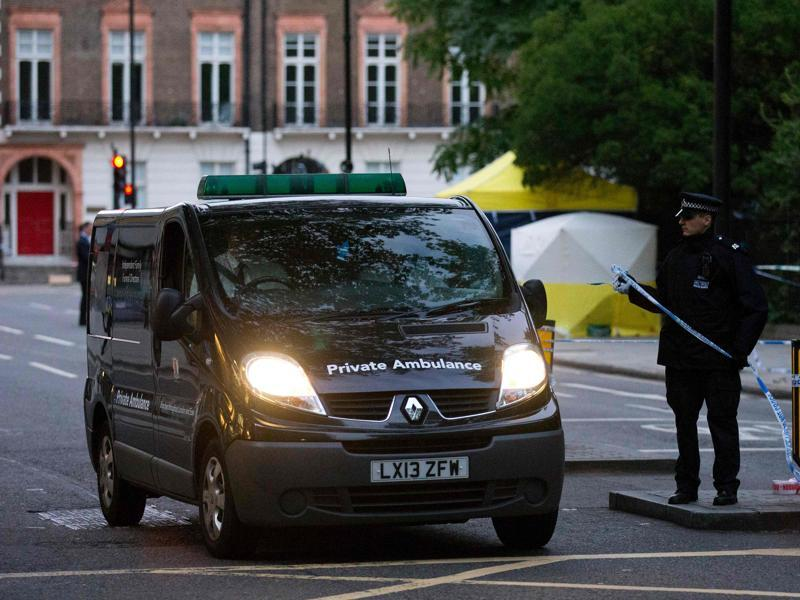 A private ambulance leaves Russell Square in London after a woman who was in her 60s was killed during a knife attack. (AFP Photo)
