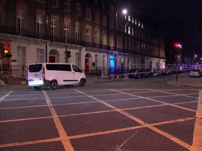 The area where a knife attack happened is cordoned off in London. (AP)