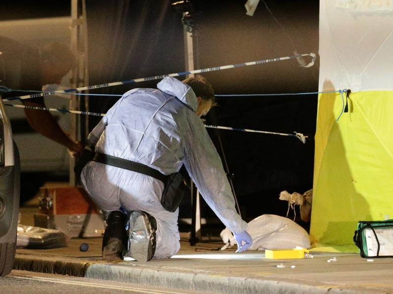 A police forensic officer works at the scene in Russell Square. (AP Photo)