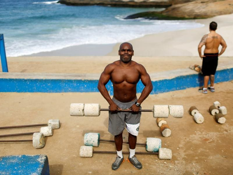 Marcos Da Costa, 46-year-old, poses as he works out at the Arpoador beach in Rio de Janeiro. When he asked if he had bought tickets for the Olympics he said,