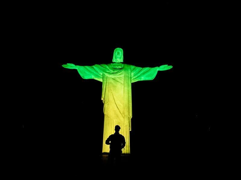 A Brazilian soldier stands guard in front of the Christ the Redeemer on Corcovado mountain ahead of the Rio 2016 Olympic Games. (AFP Photo) (AFP)