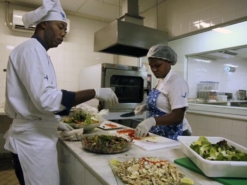 Cooks prepare meals during one of the many food-testing exercises for the Olympic menu in Rio. The have been working on special meals for participant athletes of certain sports, who are supposed to have a diet rich in calories , several times more than what the typical adult needs to get through a regular day.  (AP)