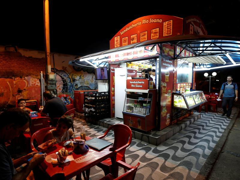 A Podrõ — the 'filthy' street sandwich stand, one of the many that ring the edges of the busiest night life districts in Rio. They serve cheap hamburgers, hotdogs and other sandwiches on a griddle with all the trimmings, just the thing you need after a night of partying. (REUTERS)