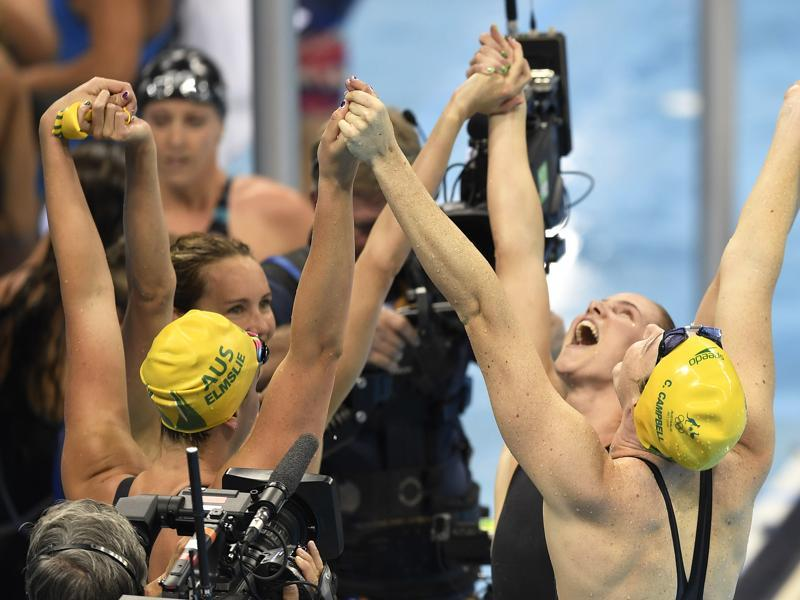 Australia's Emma McKeon, Brittany Elmslie, Bronte Campbell and Cate Campbell celebrate after winning the gold medal and setting a new world record in Rio de Janeiro, Brazil.  (AP)