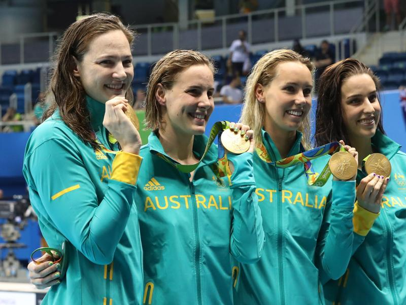 PEARLY WHITES: Sisters Cate Campbell and Bronte Campbell, Emma McKeon and Brittany Elmslie, from left, hold their gold medals. (AP)