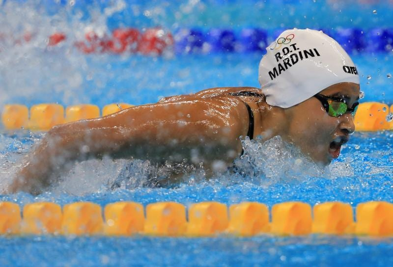 "Mardini, who braved a Mediterranean crossing in a leaky dinghy fleeing war-torn Syria, won her 100m butterfly heat to launch an ""amazing"" Olympic experience. (REUTERS)"