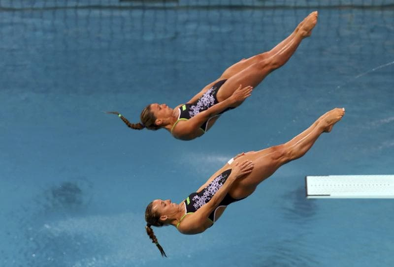 Italy's Francesca Dallape and Tania Cagnotto in action. Diving has traditionally been dominated by China, with the rest more or less fighting for the scrap. (kai pfaf/REUTERS)
