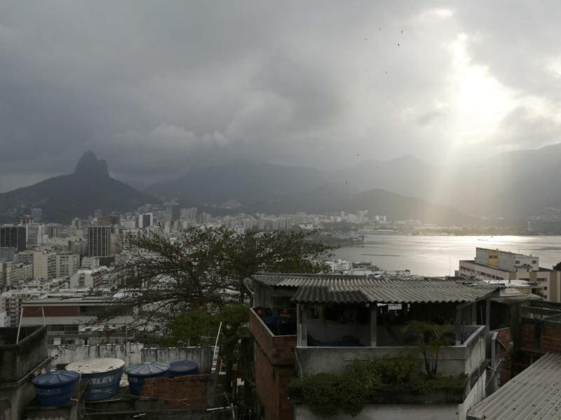 The sun shines through a cloud over the Lagoa Rodrigo de Freitas after competition was postponed due to high winds.  (REUTERS)