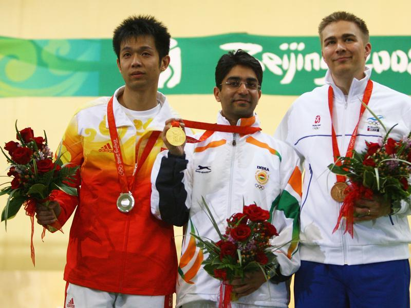 Silver medallist Zhu Qinan  (left)  was defending his gold at home that day but instead was reduced to tears after failing 0.8 point behind Bindra, who remains India's sole individual gold medallist winner. Bronze medallist Henri Hakkinen of Finland is also in the picture. (Getty Images)