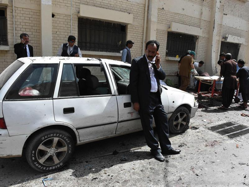 There was blood everywhere at the site of blasts, with bodies lying all over. Pakistani lawyers talk on mobiles next to bodies of their colleagues after a bomb explosion at a government hospital premises in Quetta on Monday. (AFP)