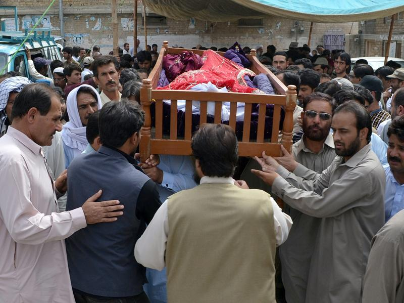 The blast, followed by firing, occurred as a crowd of some 200 people, mostly lawyers and journalists, gathered at Quetta's Civil Hospital to accompany the body of Balochistan Bar Association president Bilal Anwar Kasi, who was shot dead by unidentified gunmen while on his way to work. (AP)