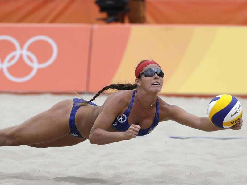 It is not just water that athletes dive into, however. Unites States' Brooke Sweat dives for the ball in the beach volleyball match against Poland on Sunday. (marcio jose sanchez/AP)