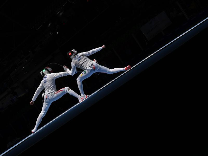 TOPSHOT - Austria's Rene Pranz (L) competes against Brazil's Guilherme Toldo during their men's individual foil qualifying bout as part of the fencing event of the Rio 2016 Olympic Games, on August 7, 2016, at the Carioca Arena 3, in Rio de Janeiro. / AFP PHOTO / Kirill KUDRYAVTSEV (AFP)