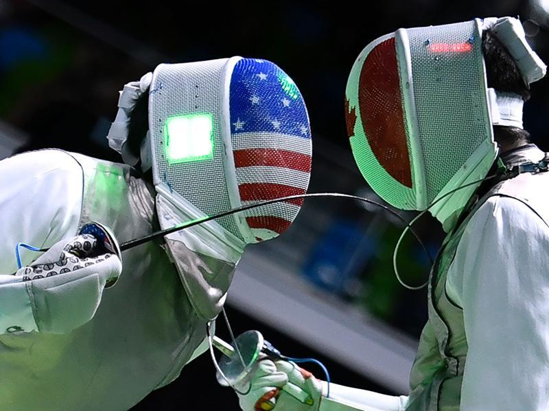 US Gerek Meinhardt (L) competes against Canada's Maximilien Van Haaster during their men's individual foil qualifying bout as part of the fencing event. (AFP Photo)
