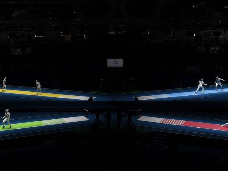 Women compete in the individual saber qualifying rounds. (AFP Photo)