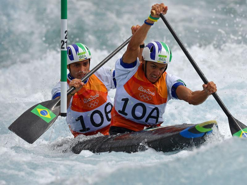 Brazil's Anderson Oliveira and Brazil's Charles Correa (front) compete in the Men's C2 canoe slalom competition. (AFP)