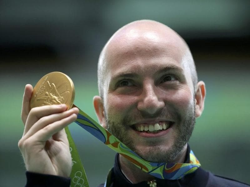 Niccolo Campriani of Italy poses with his gold medal after winning the Men's 10m Air Rifle event. (REUTERS)