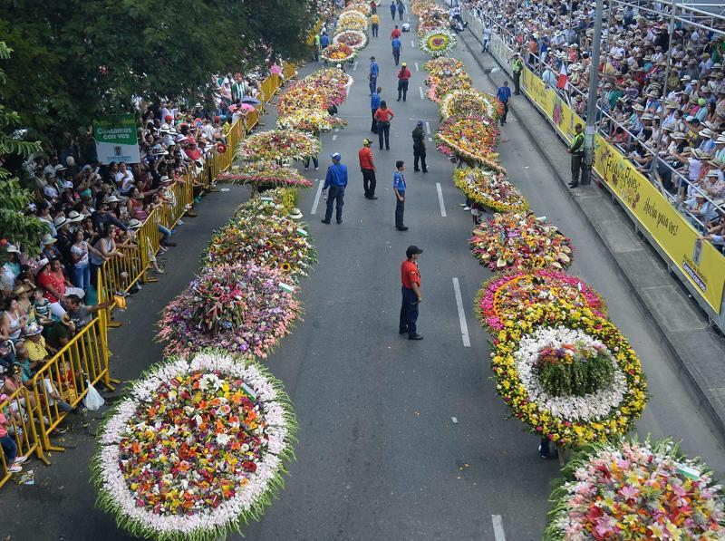 People carry flower arrangements in the traditional Silleteros parade, held as part of the Flower Festival in Medellin, Antioquia department, Colombia, on August 7, 2016.  (AFP)