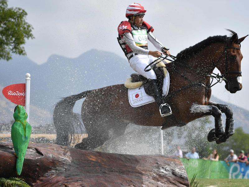 Japan's Yoshiaki Oiwa on The Duke of Cavan competes in the Eventing's Individual Cross Country. (AFP Photo)