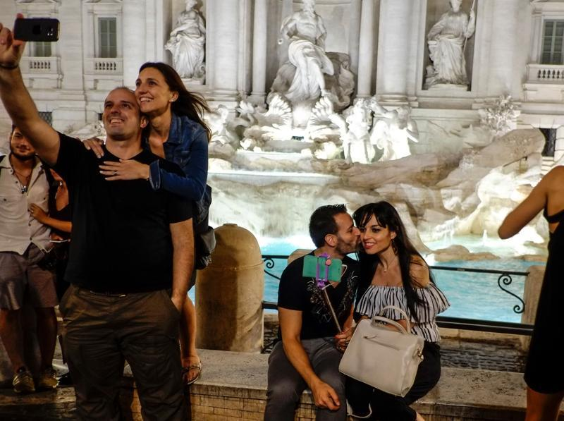 People take selfie pictures in front of the Trevi Fountain, downtown Rome. (AFP)