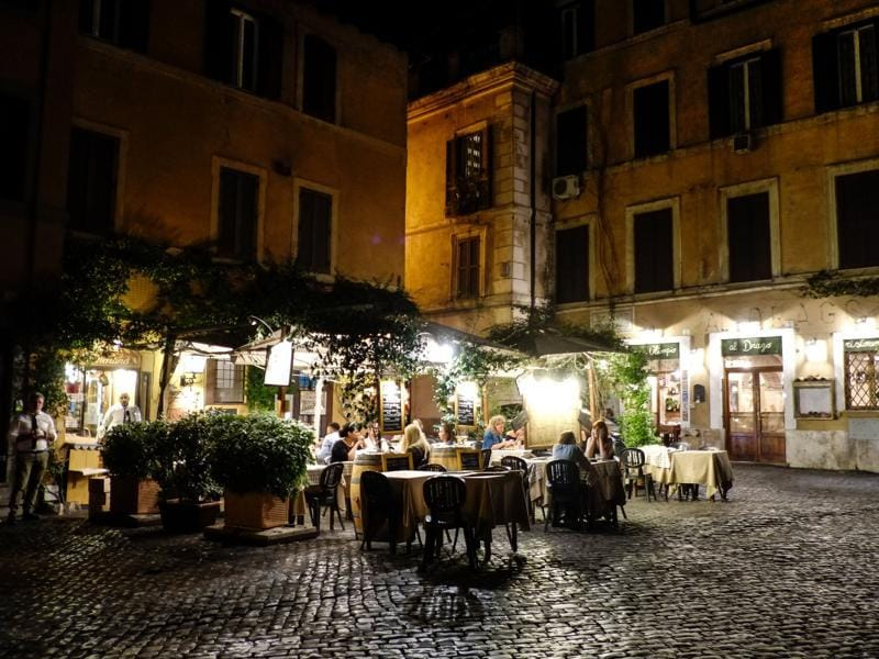 People sit on a terrace of a restaurant in the district of Trastevere. (AFP)