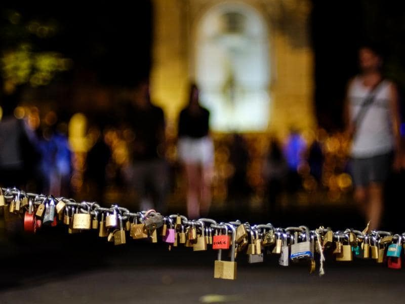 Padlocks are hung on a chain next to the fountain on Piazza Trilussa (Trilussa Square). (AFP)