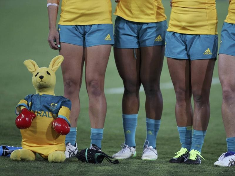 A toy kangaroo stands next to Australian players as they sing their national anthem.  (REUTERS)
