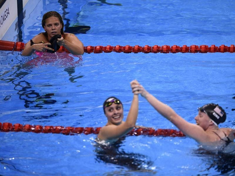 Russia's Yulia Efimova  looks on as  King and Meili celebrate after the finish of 100m breaststroke final. (AFP photo)
