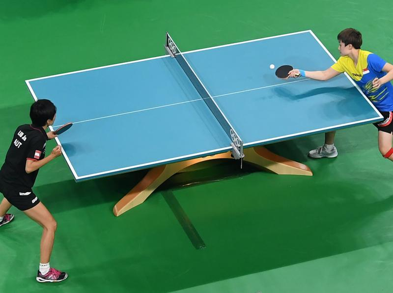 An overview shows Austria's Jia Liu playing against Singapore's Chen Feng (R) during their women's singles qualification table tennis match. (AFP Photo)