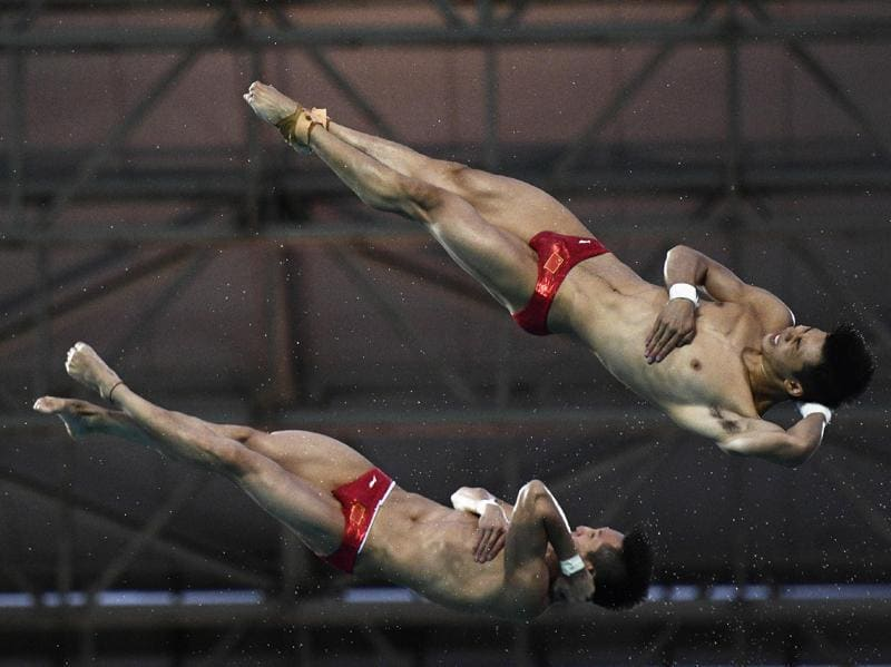 China's Lin Yue and China's Chen Aisen compete in the Men's Synchronised 10m Platform contest during the diving event. (AFP Photo)