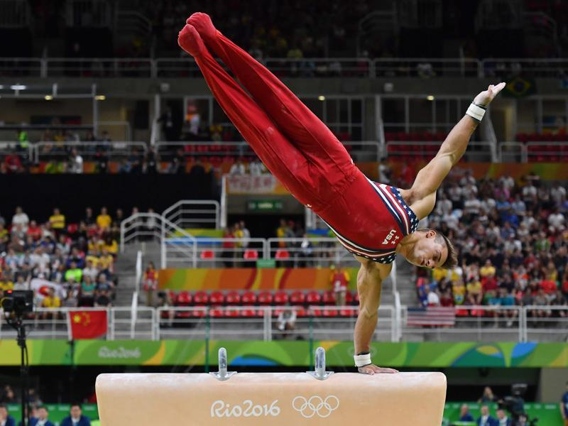 US gymnast Samuel Mikulak competes in the pommel horse event of the men's team final of the Artistic Gymnastics. (AFP Photo)