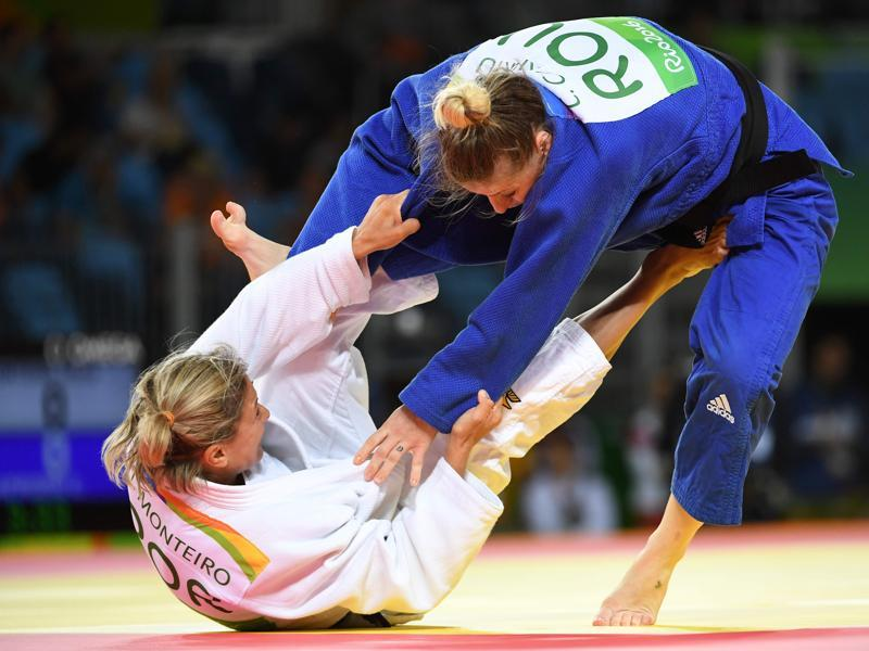 Portugal's Telma Monteiro (white) competes with Romania's Corina Caprioriu during their women's -57kg judo contest bronze medal match. (AFP Photo)