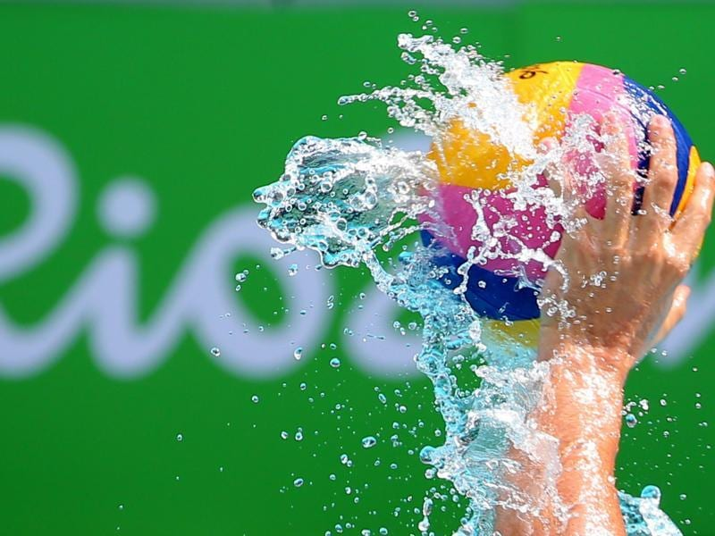 Marton Vamos of Hungary holds the ball during a water polo match. (REUTERS)