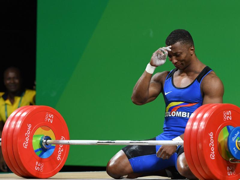 Colombia's Oscar Albeiro Figueroa Mosquera reacts after he won the Men's 62kg weightlifting competition at the Rio 2016 Olympic Games. (AFP Photo)