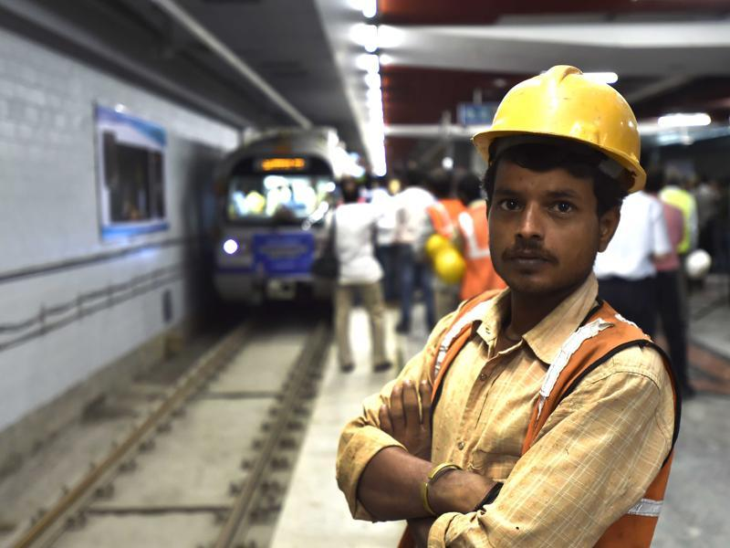 A worker poses for a picture during the trial run of Metro's heritage line between ITO and Kashmere Gate. (AJay Aggarwal/HT PHOTO)