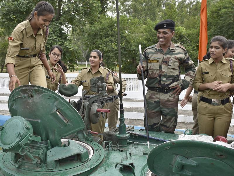LET ME TRY! NCC cadets atop a tank, checking it out and asking questions,  at an army exhibition in Amritsar on Wednesday. (Gurpreet Singh/HT Photo)