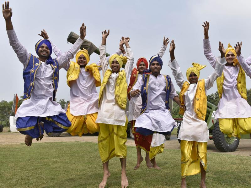 BHANGRA HERE TOO! Youngsters display bhangra at an exhibition 'Know Our Forces' organised by the Indian Army at Panther Stadium in the cantonment area of Amritsar on Wednesday. (Gurpreet Singh/HT Photo)