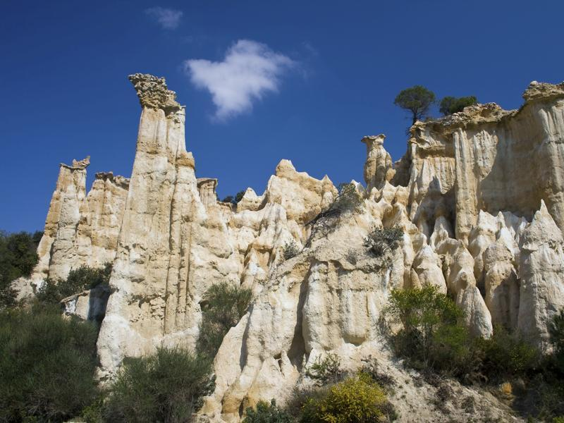 "If you want to see a masterpiece of nature, head to Illes-sur-Têt, in the Pyrénées-Orientales region of France, where stunning rock formations known as ""fairy chimneys"" can be seen. Water has slowly carved the rock into dramatic peaks pointing towards the sky. This unique landscape has been created over five million years. (iStockphoto)"
