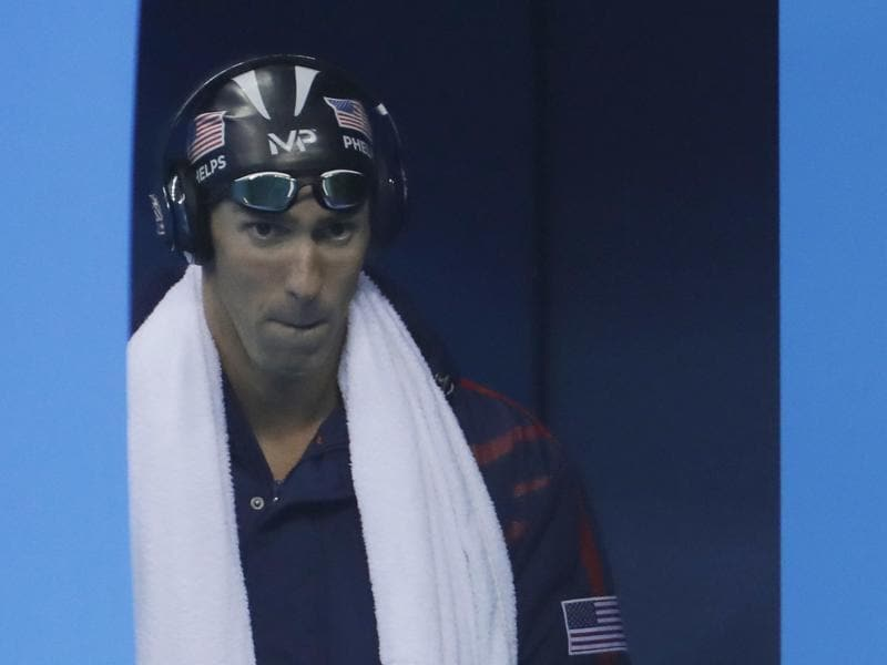 Game face on! Phelps arrives for the final of the men's 200-metre butterfly final. (AP photo)