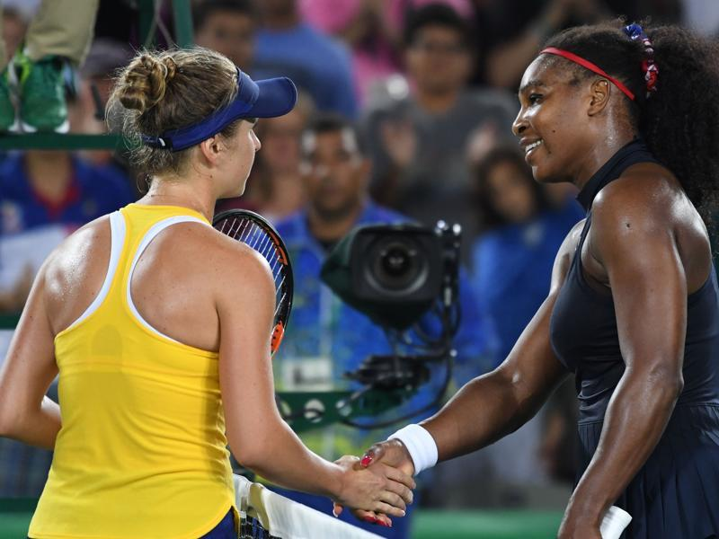 Serena Williams congratulates Elina Svitolina after the third-round match. (AFP Photo)