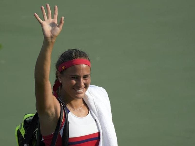 Monica Puig  celebrates after winning her match against third seed Garbine Muguruza 6-1, 6-1. (REUTERS PHOTO)