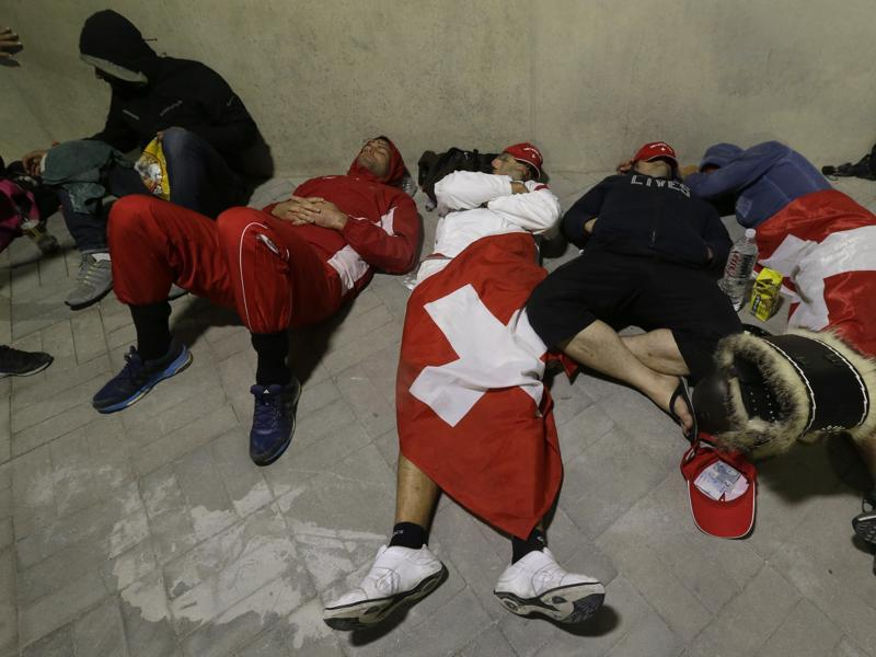 Who said Brazil is unsafe? These Swiss fans surely feel safe sleeping outside a venue. (AP)