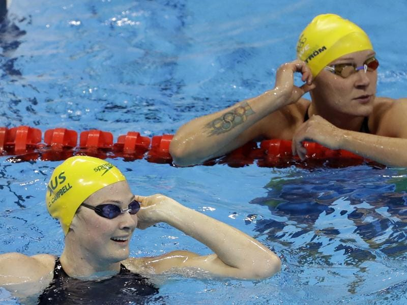 Australia's Cate Campbell, left, celebrates winning a semifinal of the women's 100-meter freestyle. (AP Photo)