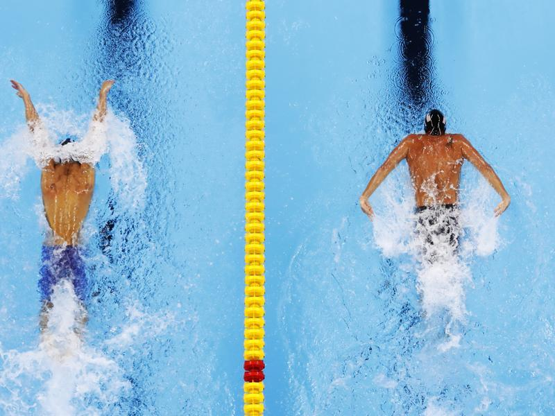 United State's Ryan Lochte, left and Michael Phelps both qualified for the 200m individual medley finals. (AP photo)