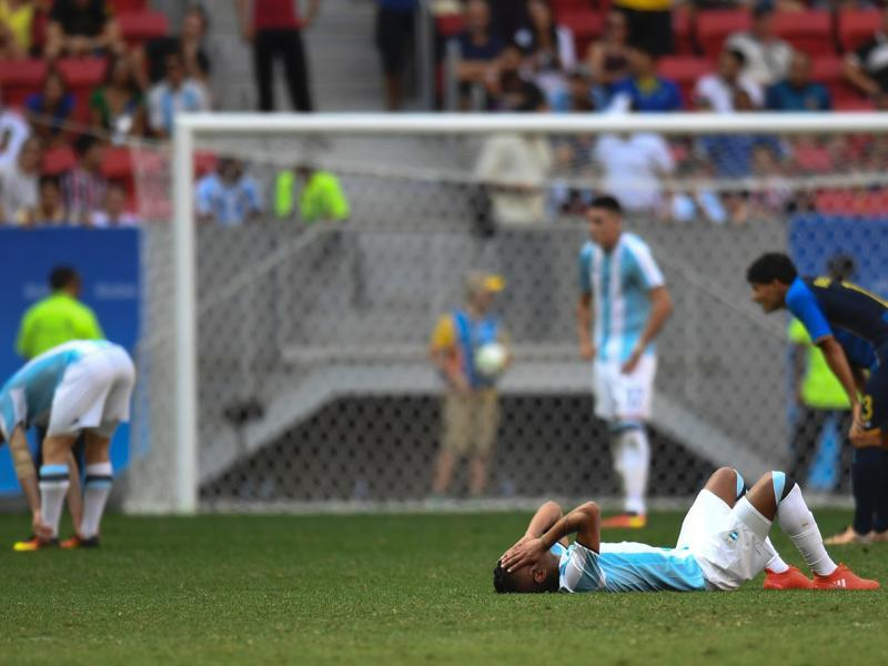 Argentina's footballers react after being eliminated from the Rio Olympics. (AFP photo)