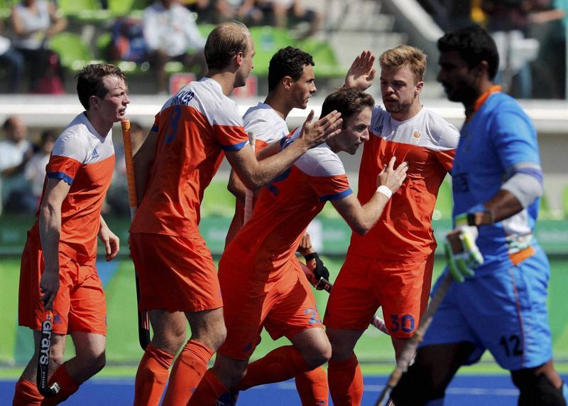 The men's hockey team reached the quarter-finals after a gap of 36 years despite being beaten 1-2 by the Netherlands for their second loss in four Pool B games. (AP)